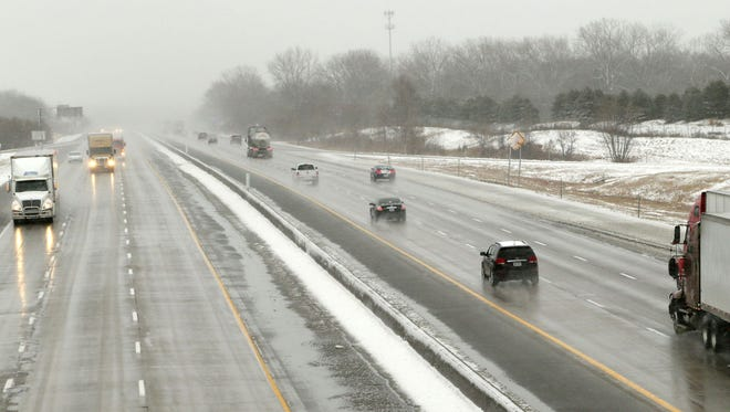 A winter mix of snow and rain makes for a sloppy commute around the metro. Crossing over I-35/I-80 bridge on 86th Street the interstate is wet but passable. Slush still covers some of the street but cautious driving is needed. Feb 20, 2014.