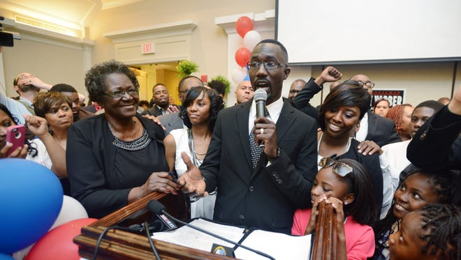 Jackson City Councilman Tony Yarber is joined by his mother, Deloris Yarber, left, wife, Rosalind  Yarber, right, as he addresses supporters gathered at the King Edward Hotel in Jackson Tuesday evening to celebrate an apparent run-off victory against opponent Chokwe Antar Lumumba to fill the remainder of late Mayor Chokwe Lumumba's term.