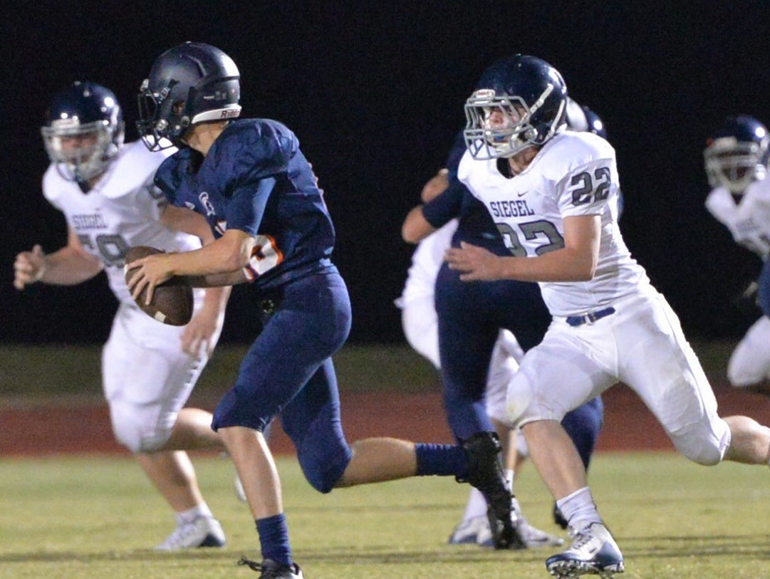 Siegel sophomore Mason Loupe (22) is shown pursuing a Summit football player during the Rutherford County Football Jamboree. Loupe is currently in critical condition at Vanderbilt University Medical Center after sustaining a gun-shot wound to his head.