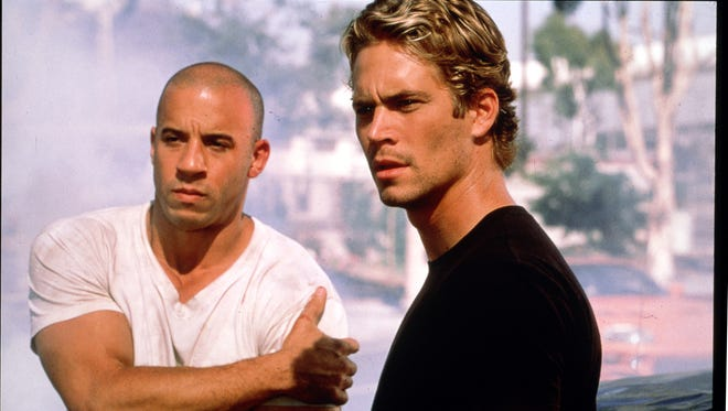 "With its constant violence, never-ending car chases and scenes full of scantily-clad women, the ""Fast and the Furious"" movies have never had an issue drawing in a male audience en route to a $1.3 billion total gross.  IN THIS PHOTO: credit: Universal Studios  Vin Diesel (left) and Paul Walker in ""The Fast and the Furious."""