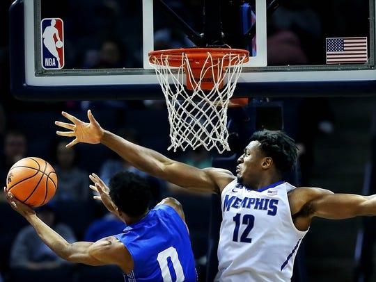 University of Memphis  forward Victor Enoh (12) takes