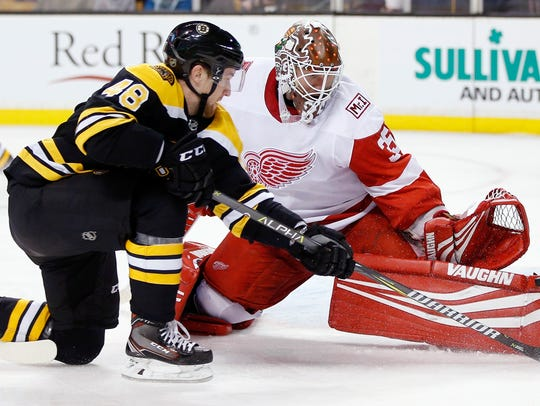 Red Wings goalie Jimmy Howard blocks a shot by the