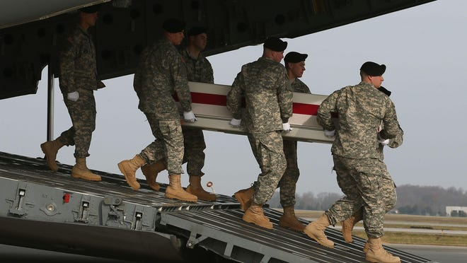 A U.S. Army carry team moves the transfer case of U.S. Army Spc. Wyatt J. Martin during a dignified transfer at Dover Air Force Base on Dec.16, 2014, in Dover. Spc. Martin, who was from Mesa, Arizona, was killed when his military vehicle was bombed by Taliban militants, near Kabul, Afghanistan.