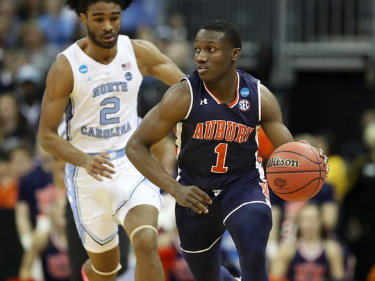 Jared Harper works with the ball during a game against North Carolina during the NCAA Tournament on March 29.