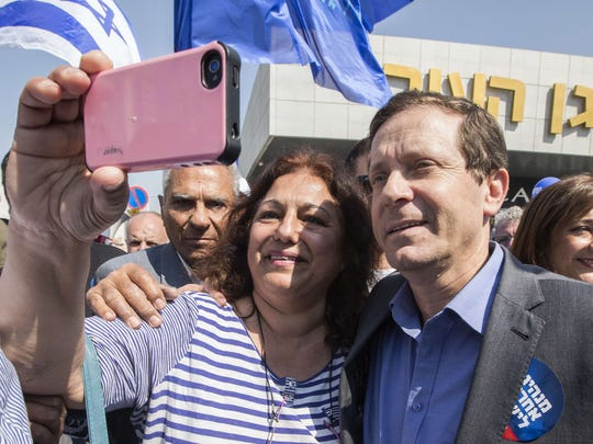 A supporter takes a selfie with Israeli Labor Party