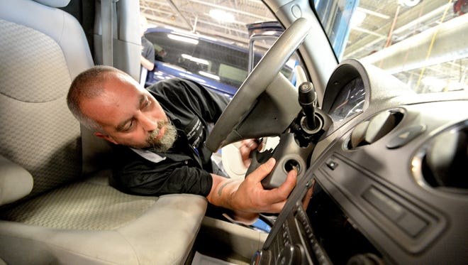 Technician Billy Morgan installs a new ignition switch during a recall repair on a Chevrolet HHR at Fitzgerald Auto Mall on June 11, 2014 in Frederick, Maryland.