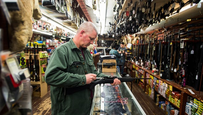 Tom Young, of Gettysburg, tests the bolt action of a .270 hunting rifle while shopping for Christmas gifts on Wednesday morning Dec. 16, 2015 at Redding's Hardware in Gettysburg.