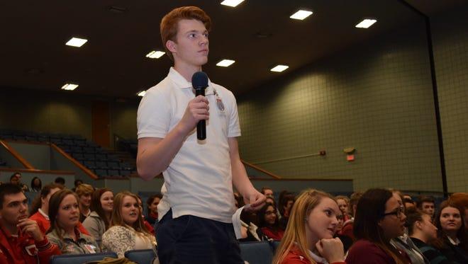 Tioga High School sophomore Wyatt Samples asks a question of U.S. Congressman Ralph Abraham, M.D., R-Alto, who spoke Wednesday at Tioga High School.