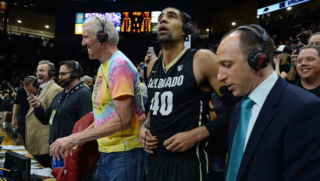 Colorado Buffaloes forward Josh Scott (40) alongside PAC 12 network analyst Bill Walton (L) following the win over the Arizona Wildcats at the Coors Events Center. The Buffaloes defeated the Wildcats 75-72.