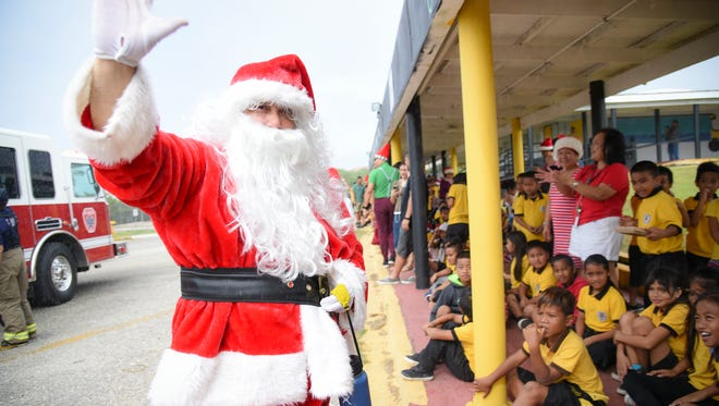 "North Pole resident Santa Claus makes an early Christmas appearance at Chief Brodie Elementary School in Tamuning on Dec. 23, 2016. ""Remember kids: be respectful, responsible, and ready for life. Have a Merry Christmas and a Happy New Year!"" exclaimed the jolly elf, adding ""Ho! Ho! HO!"""