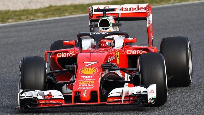 Kimi Raikkonen tests a halo head protection system in his Ferrari at Circuit de Catalunya in March 2016.