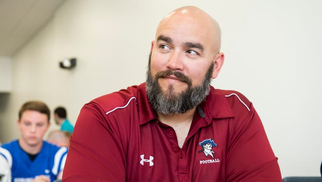 New Oxford's head coach Greg Bowman speaks with a member of the media during the YAIAA football media day in Hanover on Tuesday, August 1, 2017.