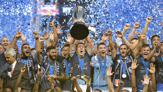 Sporting Kansas City celebrates its U.S. Open Cup win over the New York Red Bulls.