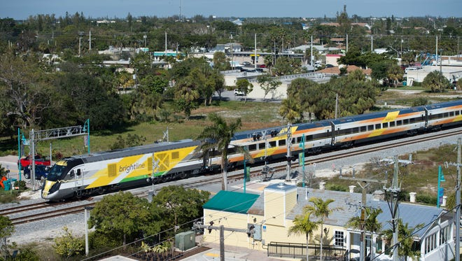 Brightline trains run between West Palm Beach and Fort Lauderdale on Thursday, Jan. 18, 2018, in Boynton Beach.