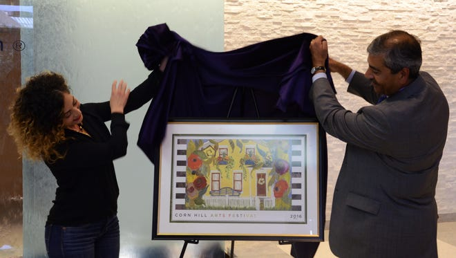 Poster artist Rachel Cordaro and Faheem Masood, President/CEO of ESL Federal Credit Union, unveiled the 2016 poster.