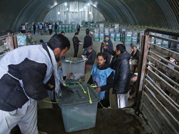 Election workers carry out ballot boxes April 6 from a truck at an Independent Elections Commission warehouse in Kabul, Afghanistan. Afghans and the international community sighed with relief that national elections were held without major violence despite a Taliban threat.