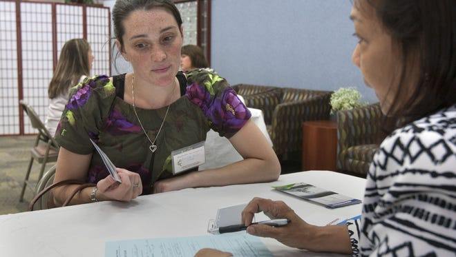 Caroline Rowan (left), Berekeley, is interviewed for a nursing assistant job at a Health South job fair by Susan Castor, chief nursing officer, in June 2015.
