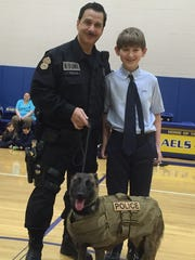 Aidan Harris with Officer Chris Zuellig and Trexx,