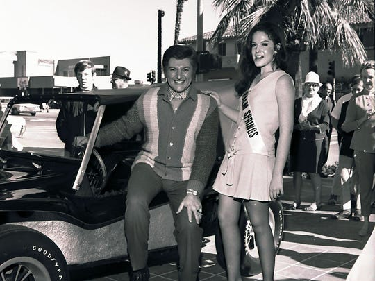 Liberace with Miss Palm Springs at the opening of Joseph Magnin Co. on January 2, 1970.