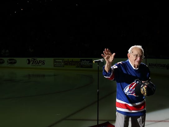 """93-year-old """"Harmonica Pete"""" DuPre waves to the crowd"""