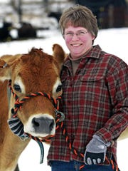 Kirsten Jurcek is shown in 2016 with cow Olivia at her home and farm, Brattset Family Farm, in the Town of Jefferson.