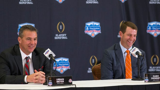 Ohio State's head coach Urban Meyer (left) and Clemson's head coach Dabo Swinney answer questions during a Fiesta Bowl press conference, December 30, 2016, at the Camelback Inn, 5402 E Lincoln Drive, Scottsdale, Arizona.