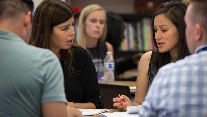 Erin Olitzky (left) and Erica Martinez talk during professional development training on April 26, 2017, at Clarendon Elementary School in Phoenix.