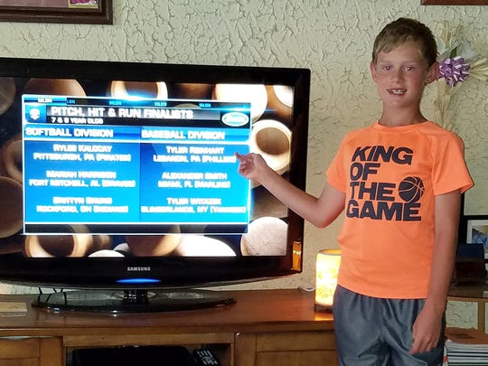 Eight-year old Lebanon native Tyler Reinhart points to his name as it appeared Monday night on MLB Network, revealing he had been earned a spot in the National Finals of  the Scotts Major League Baseball Pitch, Hit & Run competition during MLB All-Star week in San Diego.