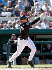 Detroit Tigers' Nicholas Castellanos hits a sacrifice fly against the New York Yankees on March 6, 2018 in Lakeland, Fla.