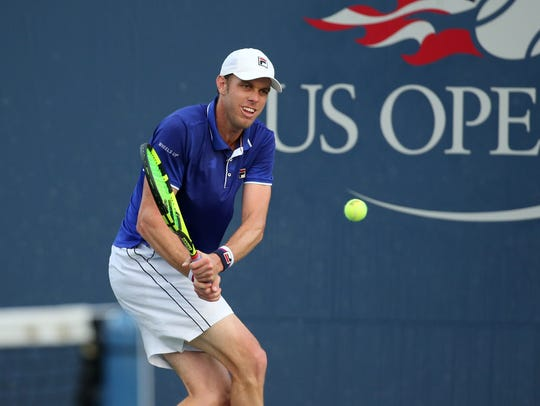 Sam Querrey of Thousand Oaks hits a backhand during