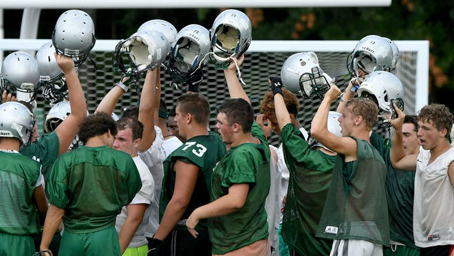 Madison Rams players stay fired up between drills Monday afternoon during the first day of football practice.