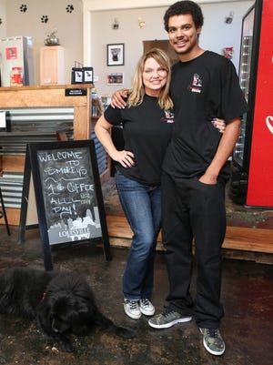 """Smokey's Bean owner Erin Lee and son D.J. Lee inside their new coffee shop at 1212 S. 4th St. The shop had their grand opening just over two weeks ago and is serving Argo coffee beans along with smoothies and sandwiches. """"I'm working seven days-a-week"""" Erinn said. """"So this is not only my work, but it's a place to socialize."""" The pet friendly coffee shop named after Erinn's dog Smokey enjoys seeing a mix of clientele since opening. """"We just try to treat everyone like family,"""" Erinn added. Oct. 29, 2015"""