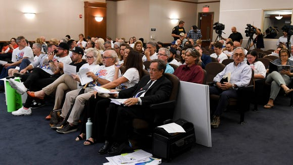 A crowd fills the meeting room at Melbourne City Hall during Thursday's Planning and Zoning Board meeting about a controversial mural in Eau Gallie
