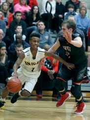 McQuaid's Anthony Iglesia dribbles away from Penfield's
