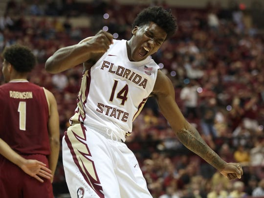 FSU's Terance Mann pumps his fist in celebration after