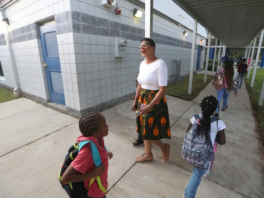 Principal Carmen Conner greets children during the first day of classes at Pineview Elementary School on Monday, Aug. 13, 2018.