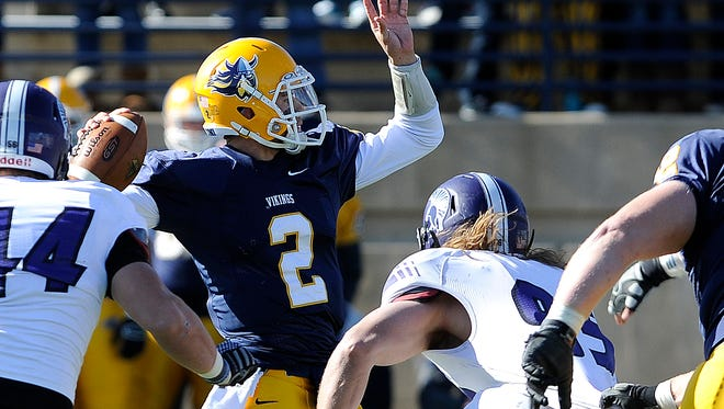 Augustana's #2 Trey Heid looks for an open teammate against Winona State at Kirkeby-Over Stadium in Sioux Falls, Saturday, Nov 1, 2014.