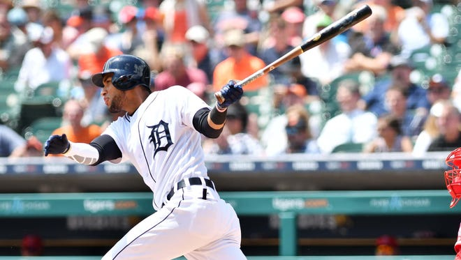 The Tigers' Victor Reyes delivers a three-run triple in the first inning Thursday at Comerica Park in Detroit.