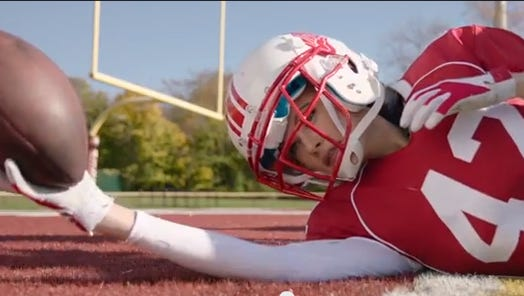 """A screen grab from """"Victoria's Secret Angels Play Football."""""""