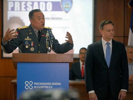 National Police Chief Ney Aldrin Bautista, left, and Attorney General Jean Alain Rodriguez, right, made a detailed presentation last week of the investigation's findings, but rumors still abound.