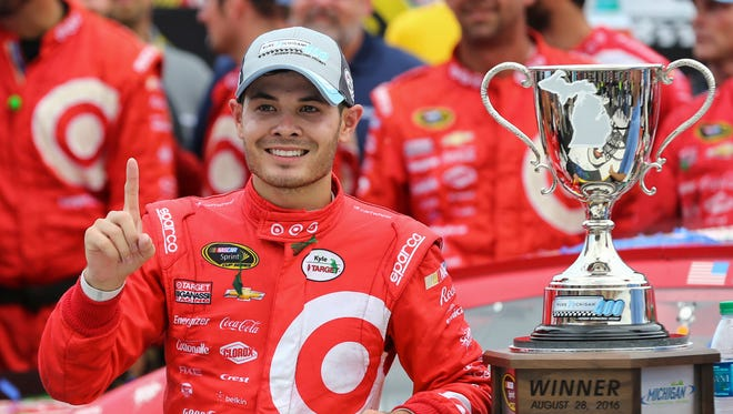 Aug 28, 2016; Brooklyn, MI, USA; Sprint Cup Series driver Kyle Larson (42) celebrates in victory lane after winning the Pure Michigan 400 at the Michigan International Speedway. Mandatory Credit: Aaron Doster-USA TODAY Sports