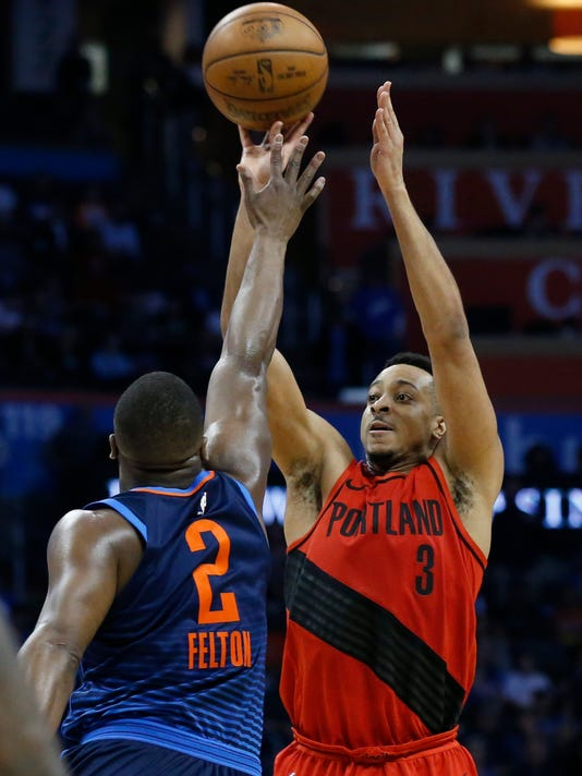 Portland Trail Blazers guard CJ McCollum (3) shoots over Oklahoma City Thunder guard Raymond Felton (2) in the second half of an NBA basketball game in Oklahoma City, Sunday, March 25, 2018. (AP Photo/Sue Ogrocki)