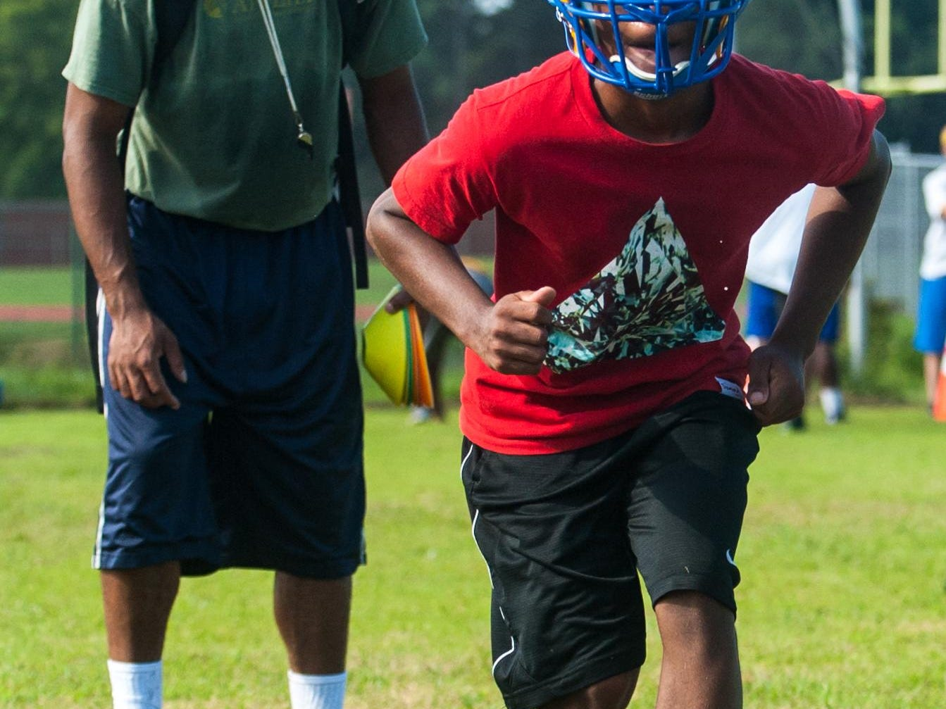 Wicomico High defensive backs work through drills on the second day of practice.