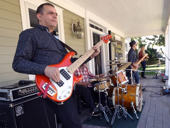 Bass player Tony Fanelli plays with Little Raymond
