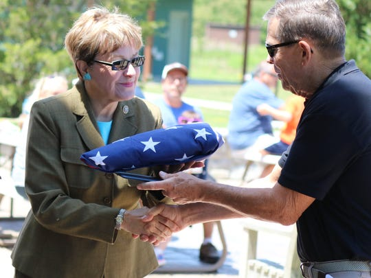 U.S. Rep. Marcy Kaptur, D-Toledo, presents Ron Overmyer, president of the Friends of the Ottawa National Wildlife Refuge, with an honorary flag to celebrate the group's 20th anniversary.