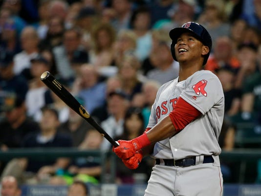 Boston Red Sox's Rafael Devers smiles after hitting a foul ball during the sixth inning of the team's baseball game against the Seattle Mariners, Tuesday, July 25, 2017, in Seattle. (AP Photo/Ted S. Warren)