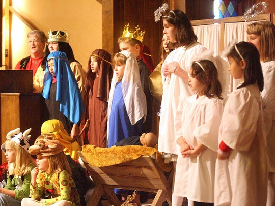 Children in costume at a Nativity Scene sing during Fellowship Presbyterian Church's Christmas Eve service in 2010.
