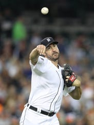 Tigers pitcher Justin Verlander throws to first base