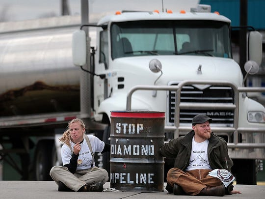 Some 40 protesters with the organization Arkansas Rising gather in front of the Valero refinery in south Memphis to protest the construction of the Diamond Pipeline. Twelve were arrested after at least seven people chained themselves to large, concrete-filled barrels.