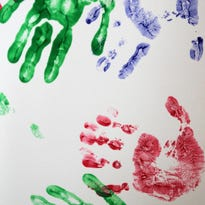 The handprints of child abuse survivors are displaced at Chaucie's Place, a Carmel-based child advocacy center.